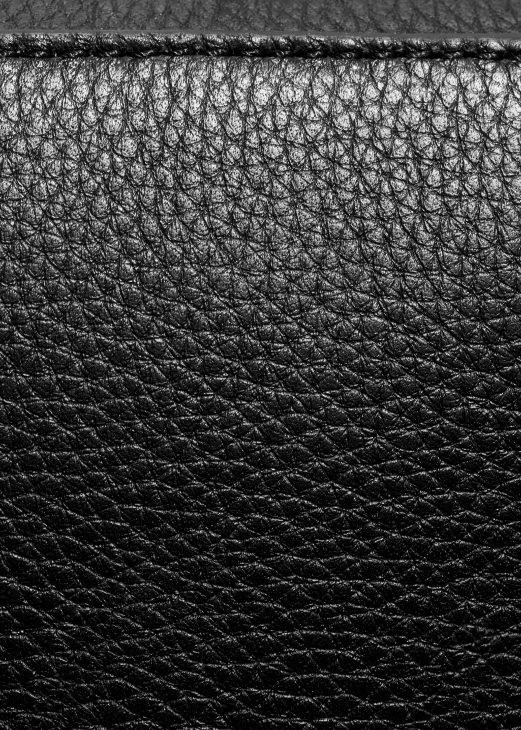 Detailed image of Stories boxy leather bag in black