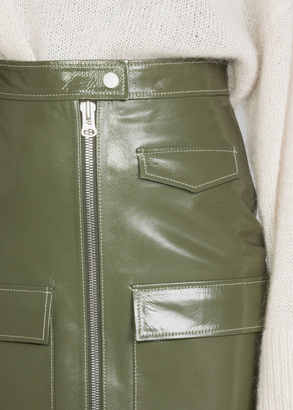 Detailed image of Stories utilitarian patent leather skirt in green