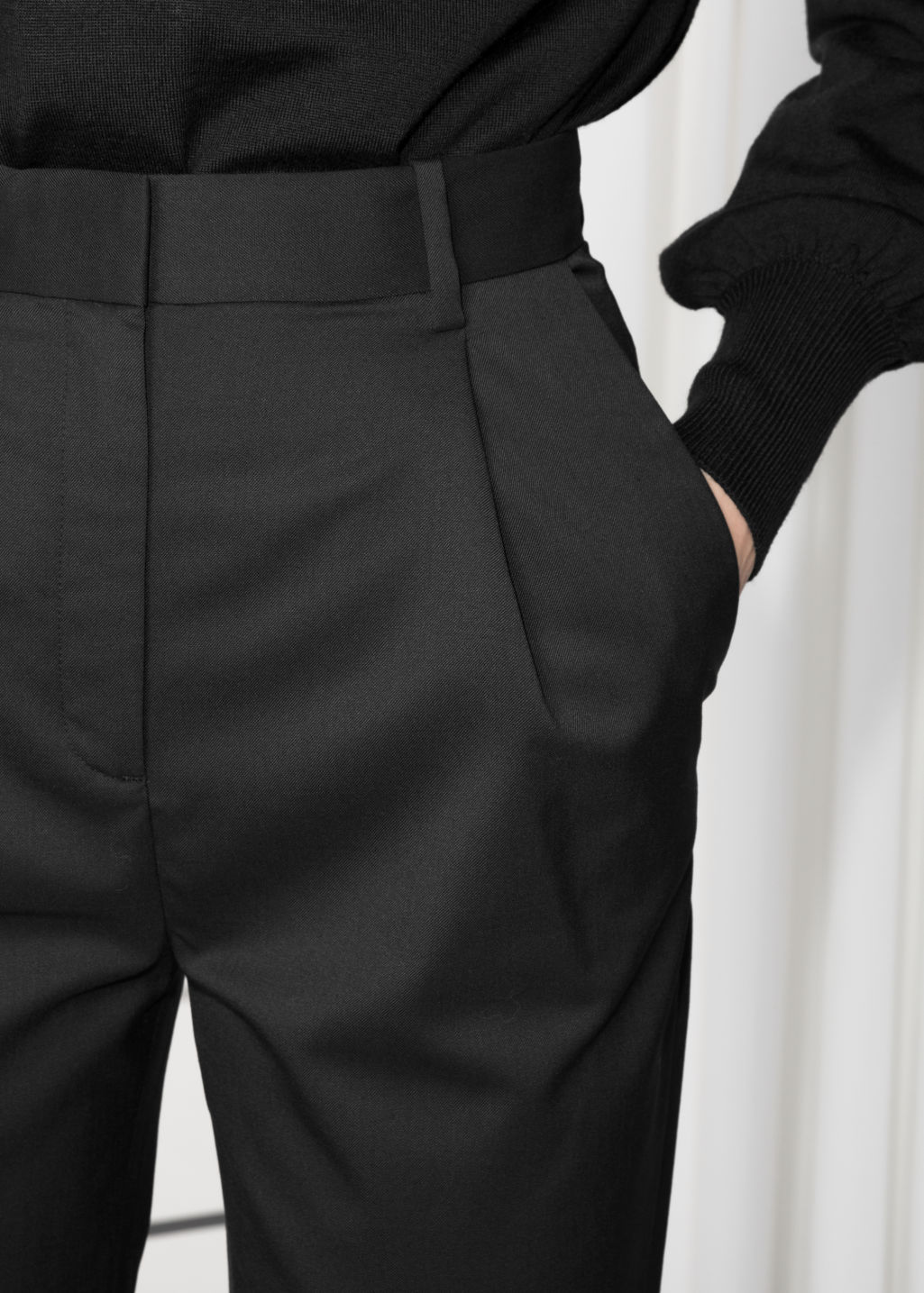 Detailed image of Stories high waisted tapered trousers in black
