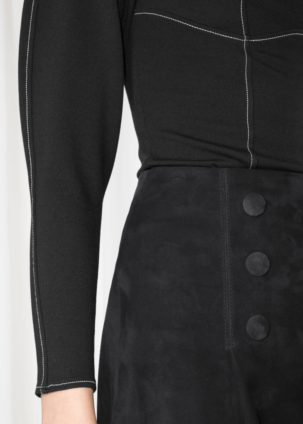 Detailed image of Stories leather button stud skirt in black
