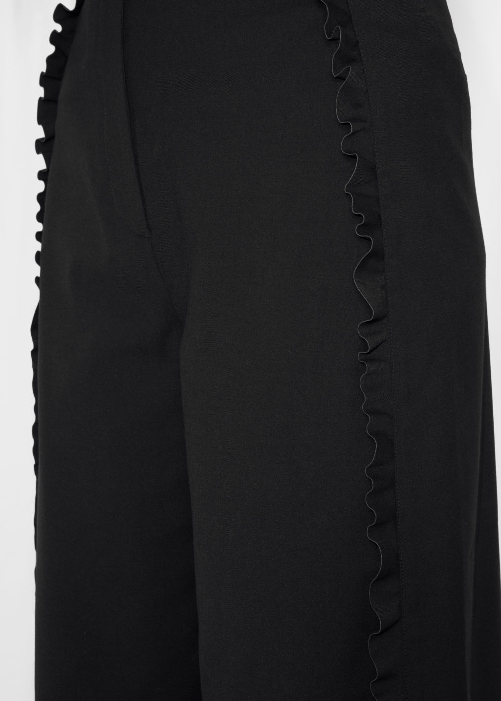 Detailed image of Stories ruffle tuxedo stripe culottes  in black