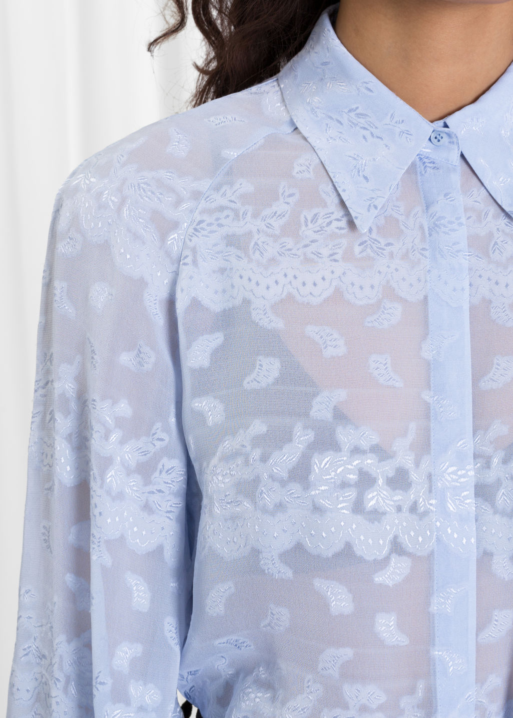 Detailed image of Stories billowy jacquard blouse in blue