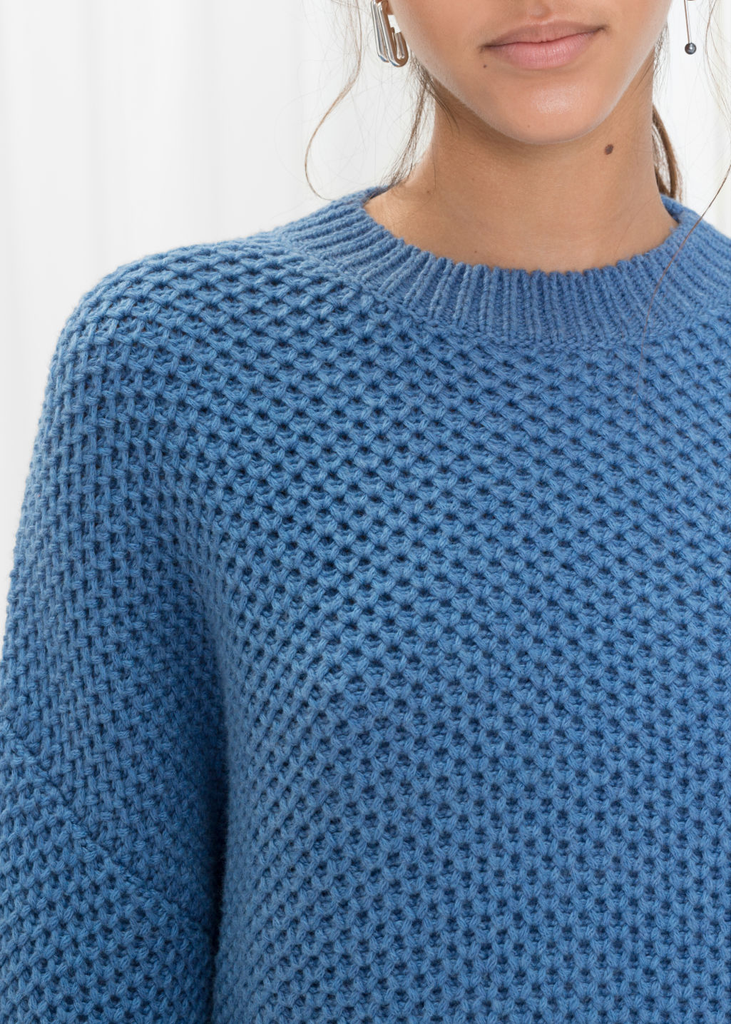 Detailed image of Stories cropped honeycomb knit sweater  in blue