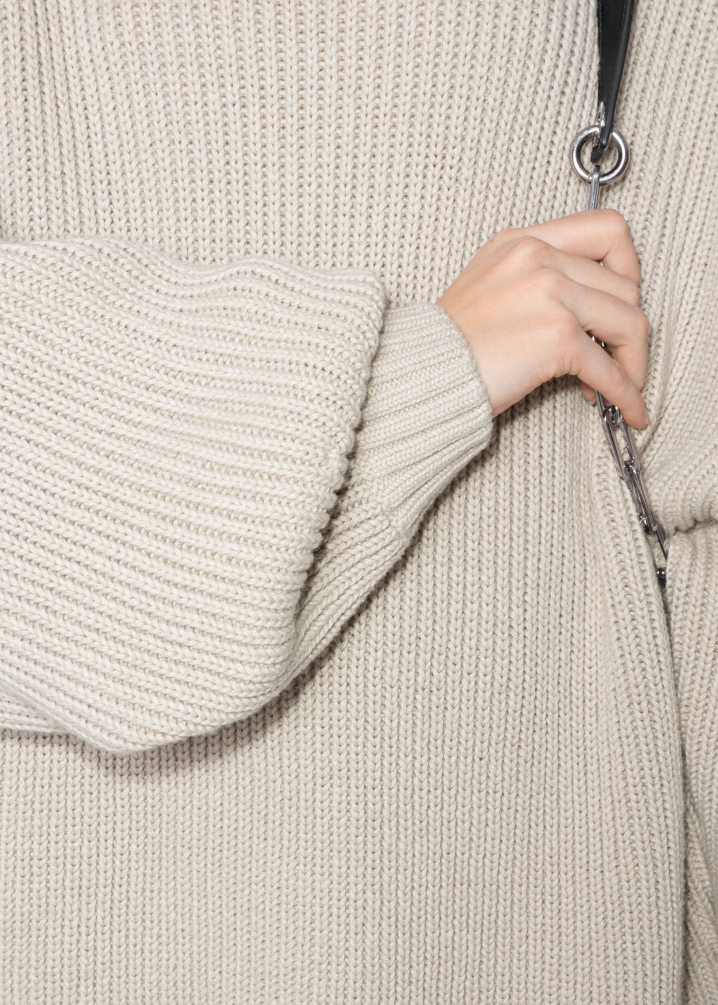 Detailed image of Stories jumbo turtleneck sweater in beige