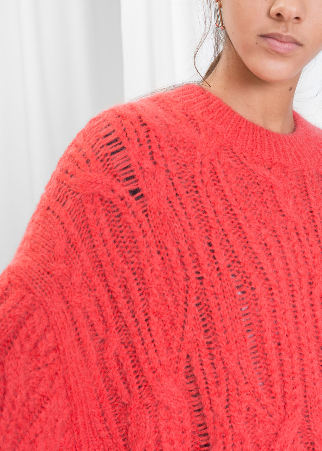 Detailed image of Stories oversized cable knit sweater in orange