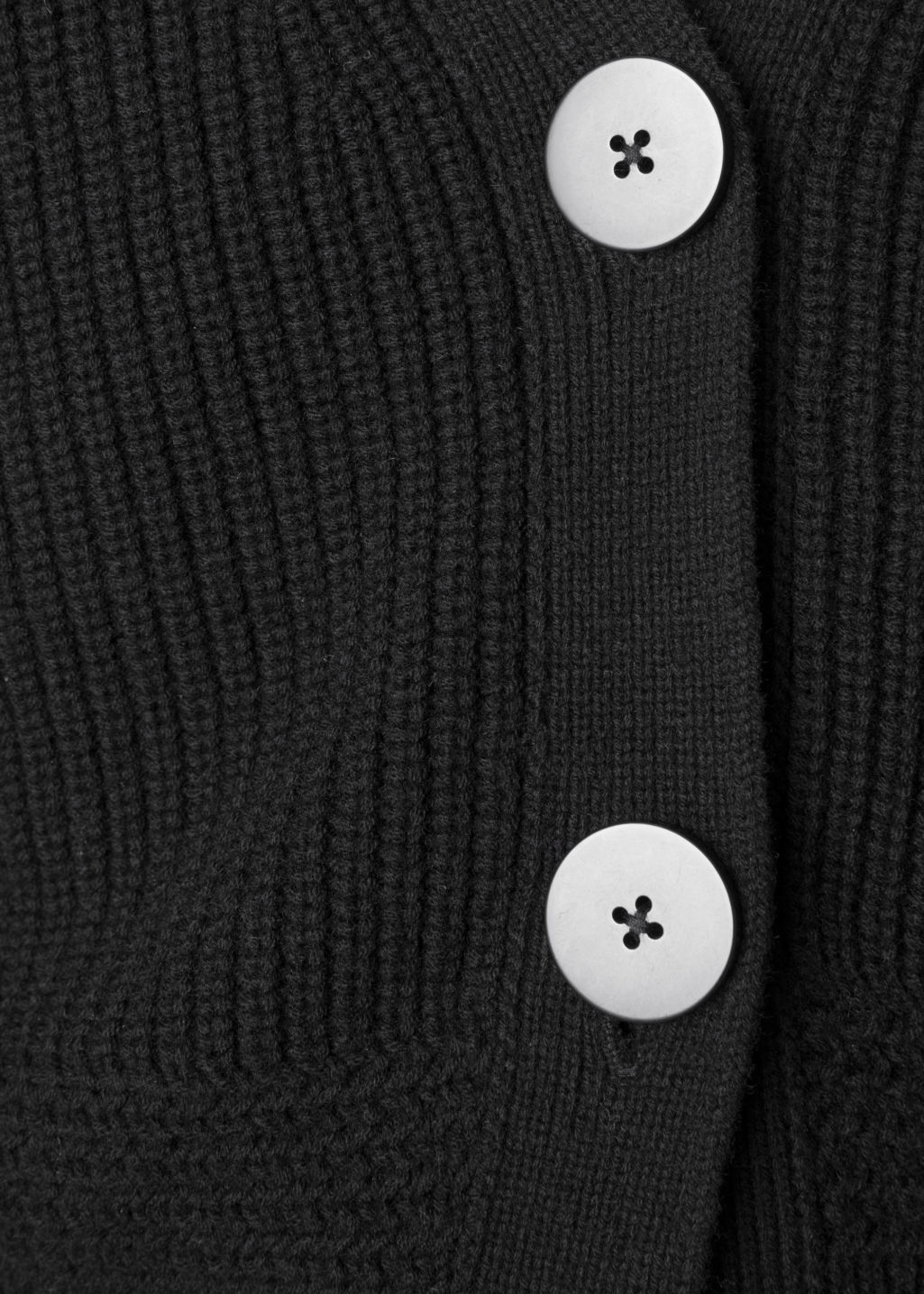 Detailed image of Stories wool button sweater in black