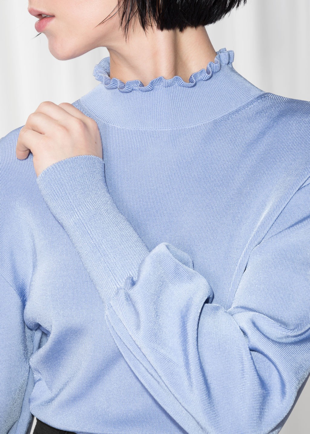 Detailed image of Stories frill mock neck top in blue