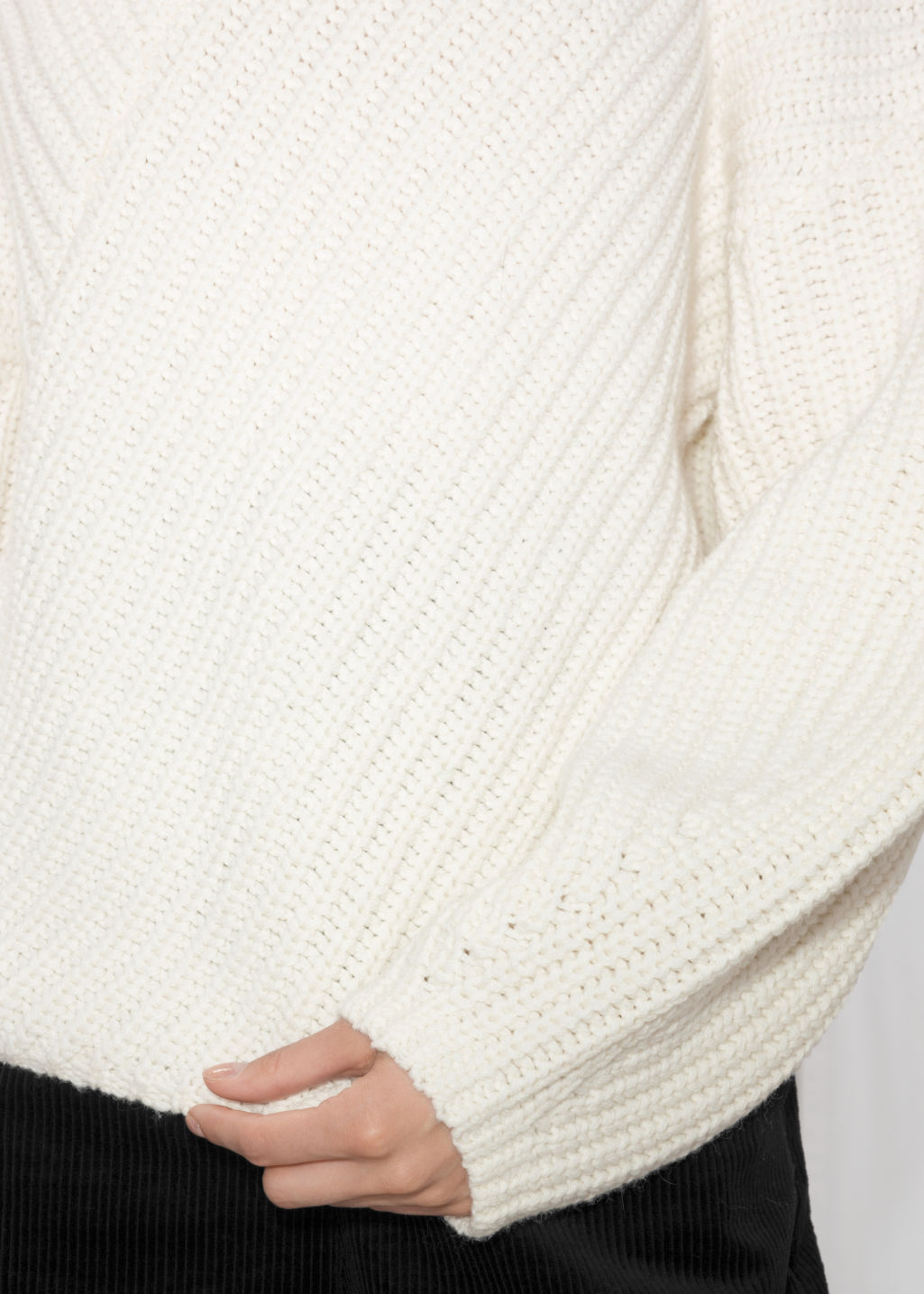 Detailed image of Stories criss cross sweater in white
