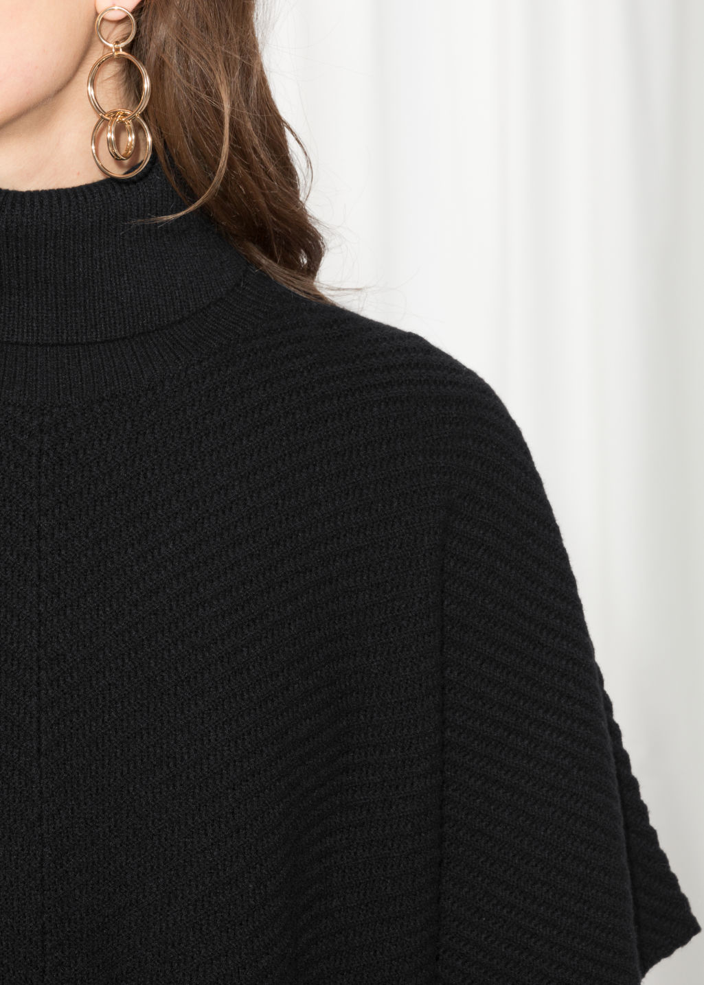 Detailed image of Stories turtleneck cape in black