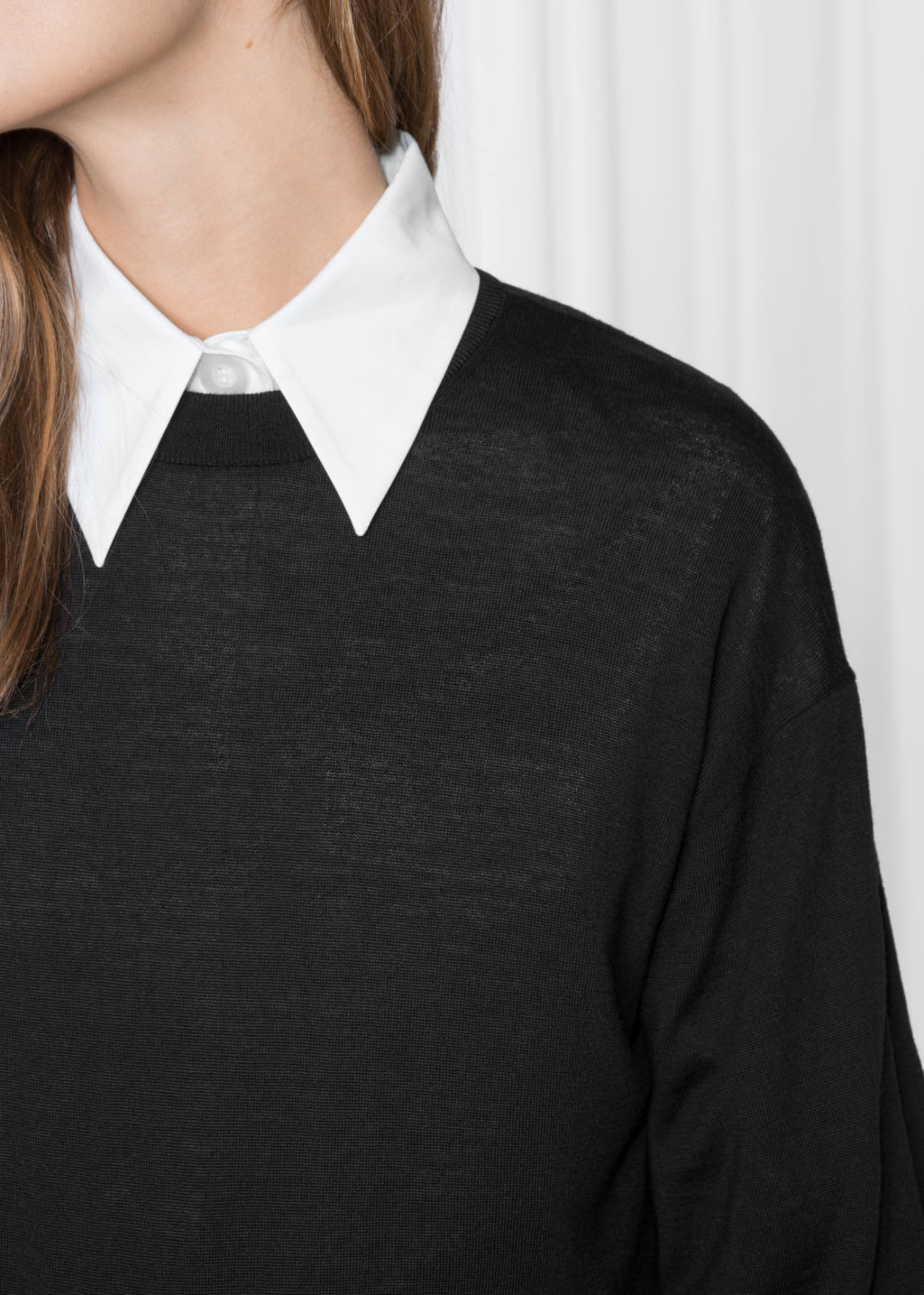 Detailed image of Stories puffy merino wool sweater  in black