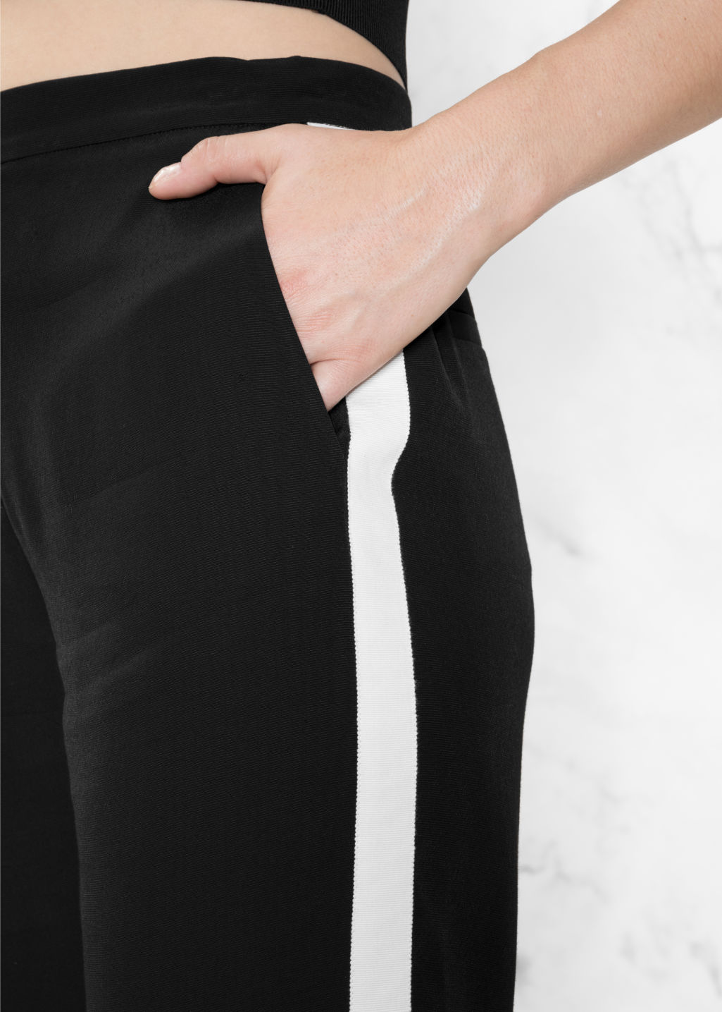 Detailed image of Stories grosgrain side panel trousers in black