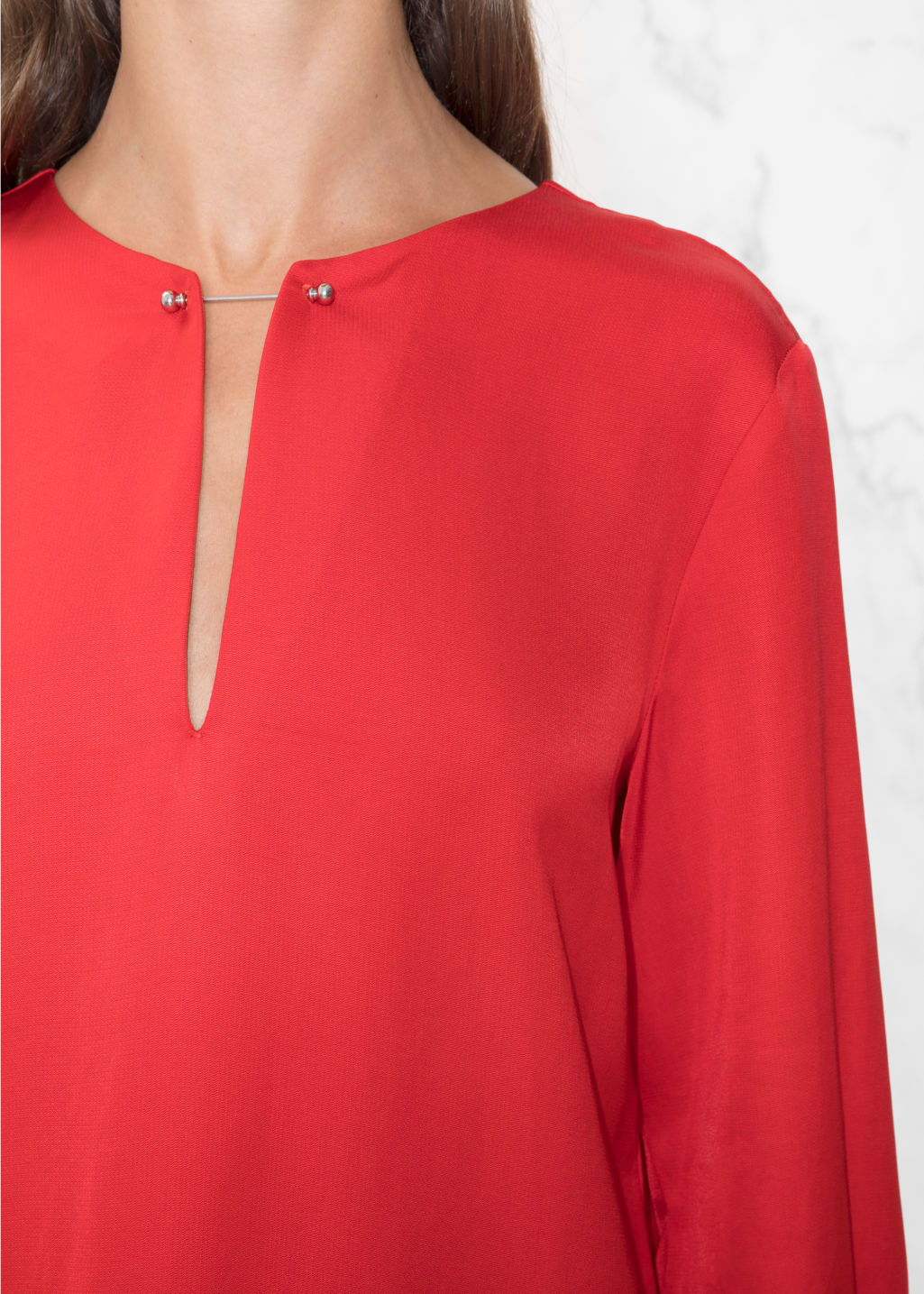 Detailed image of Stories metal bar detail dress in red