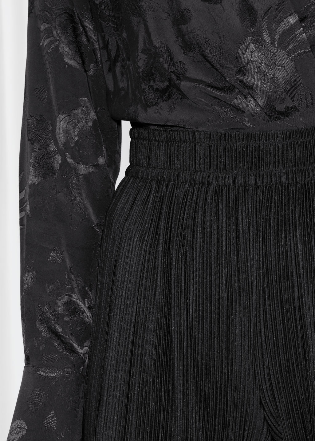Detailed image of Stories high waisted pleated trousers in black