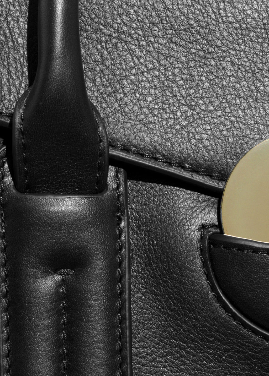 Detailed image of Stories circle detail leather bag in black