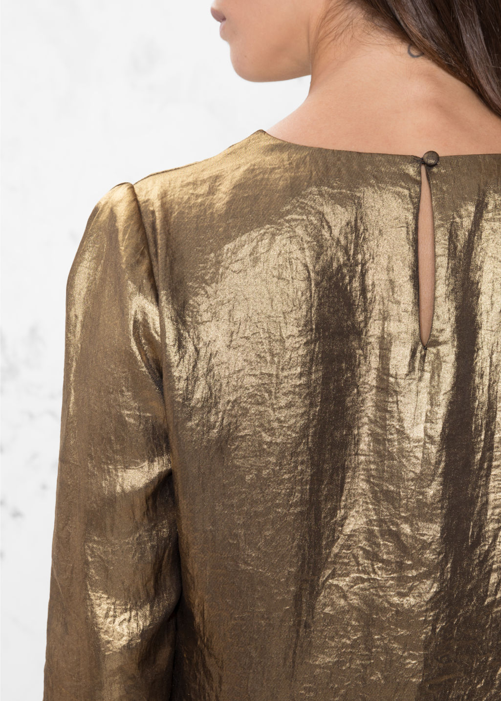 Detailed image of Stories metallic satin blouse  in gold