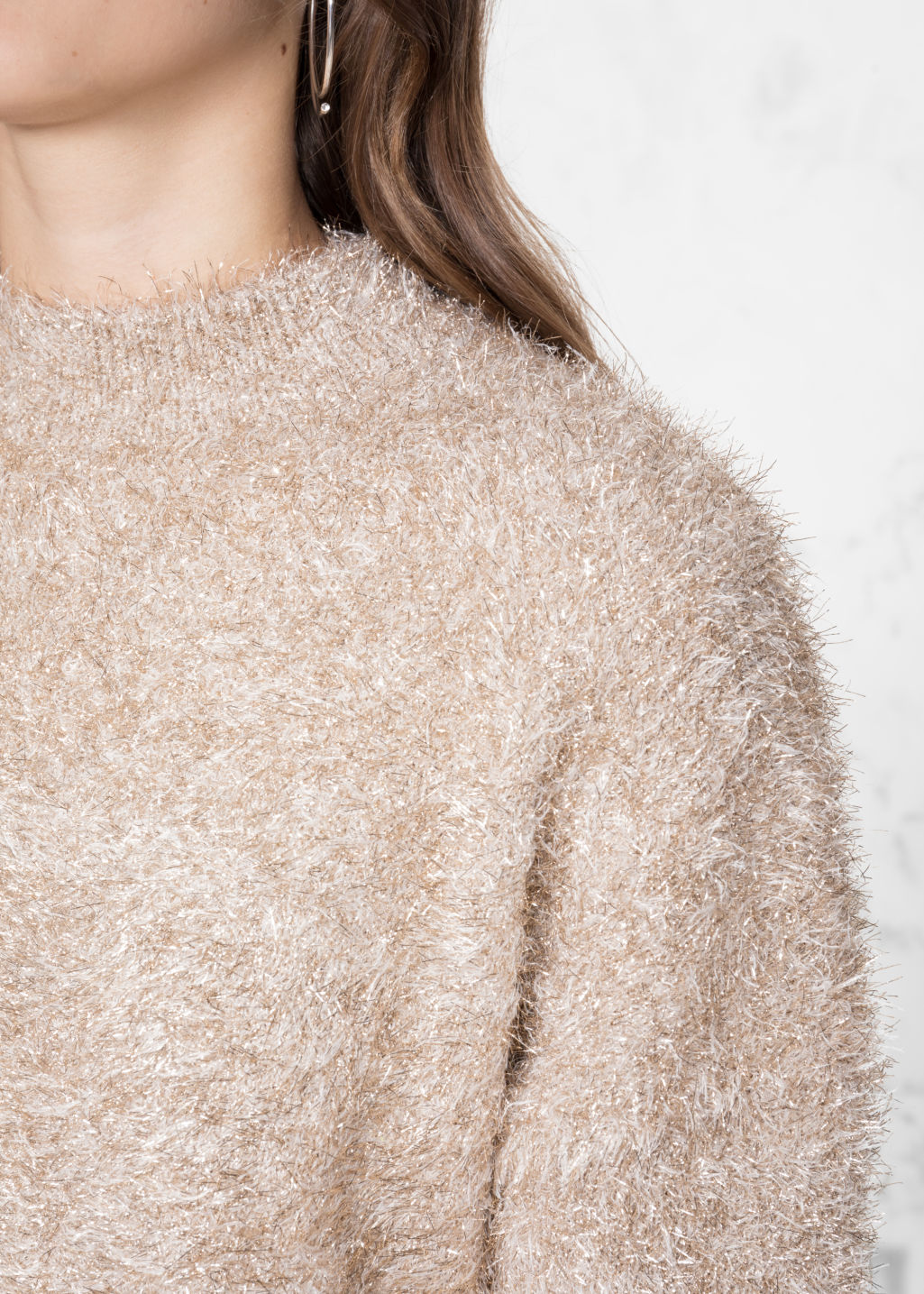 Detailed image of Stories fuzzy sweater in gold