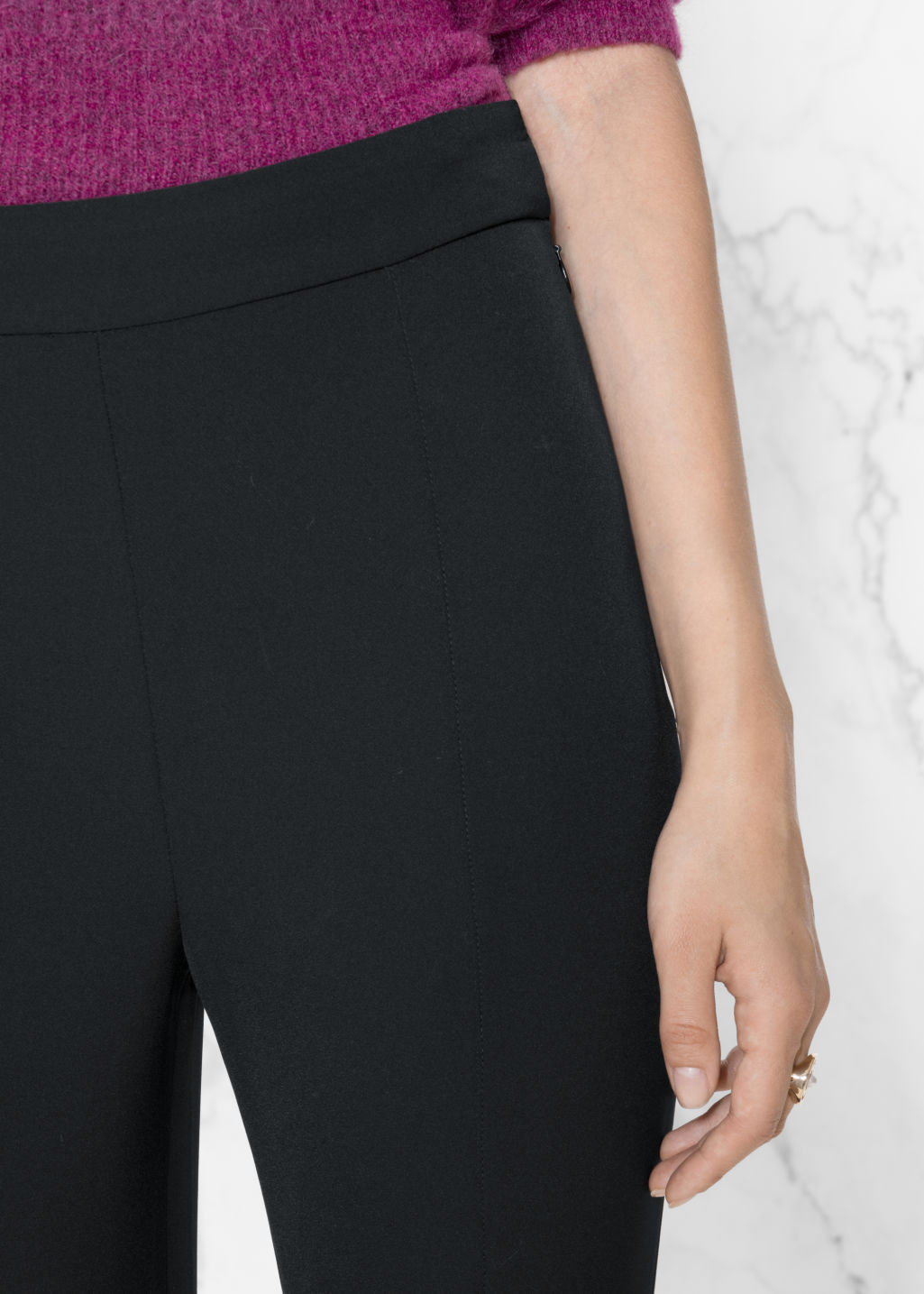 Detailed image of Stories stirrup trousers in black