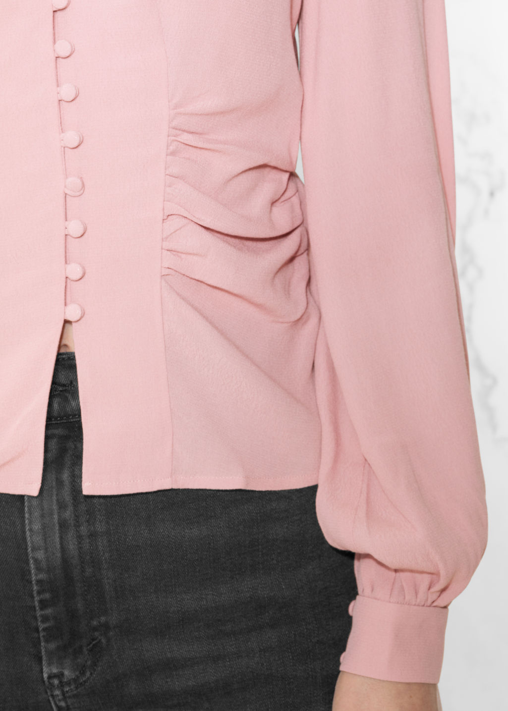 Detailed image of Stories ruffled v-neck blouse in pink