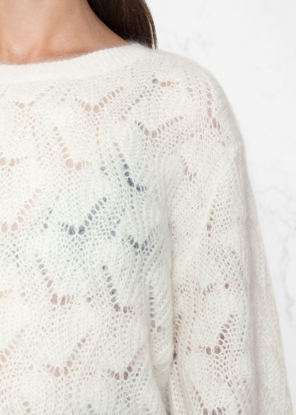 Detailed image of Stories merino wool sweater in white