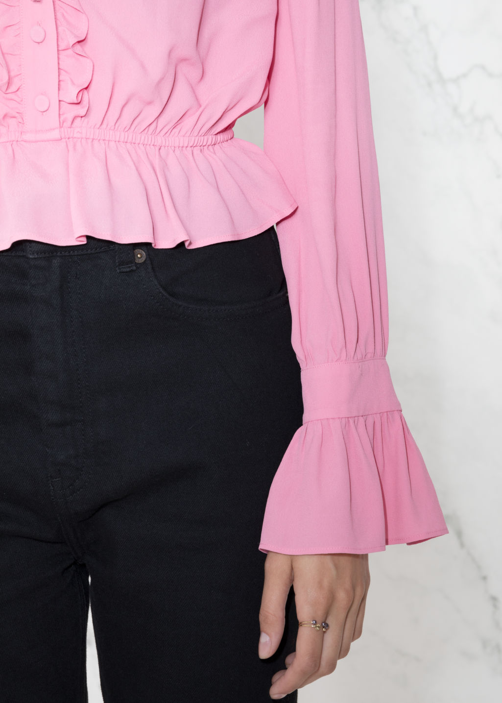Detailed image of Stories ruffled blouse in pink