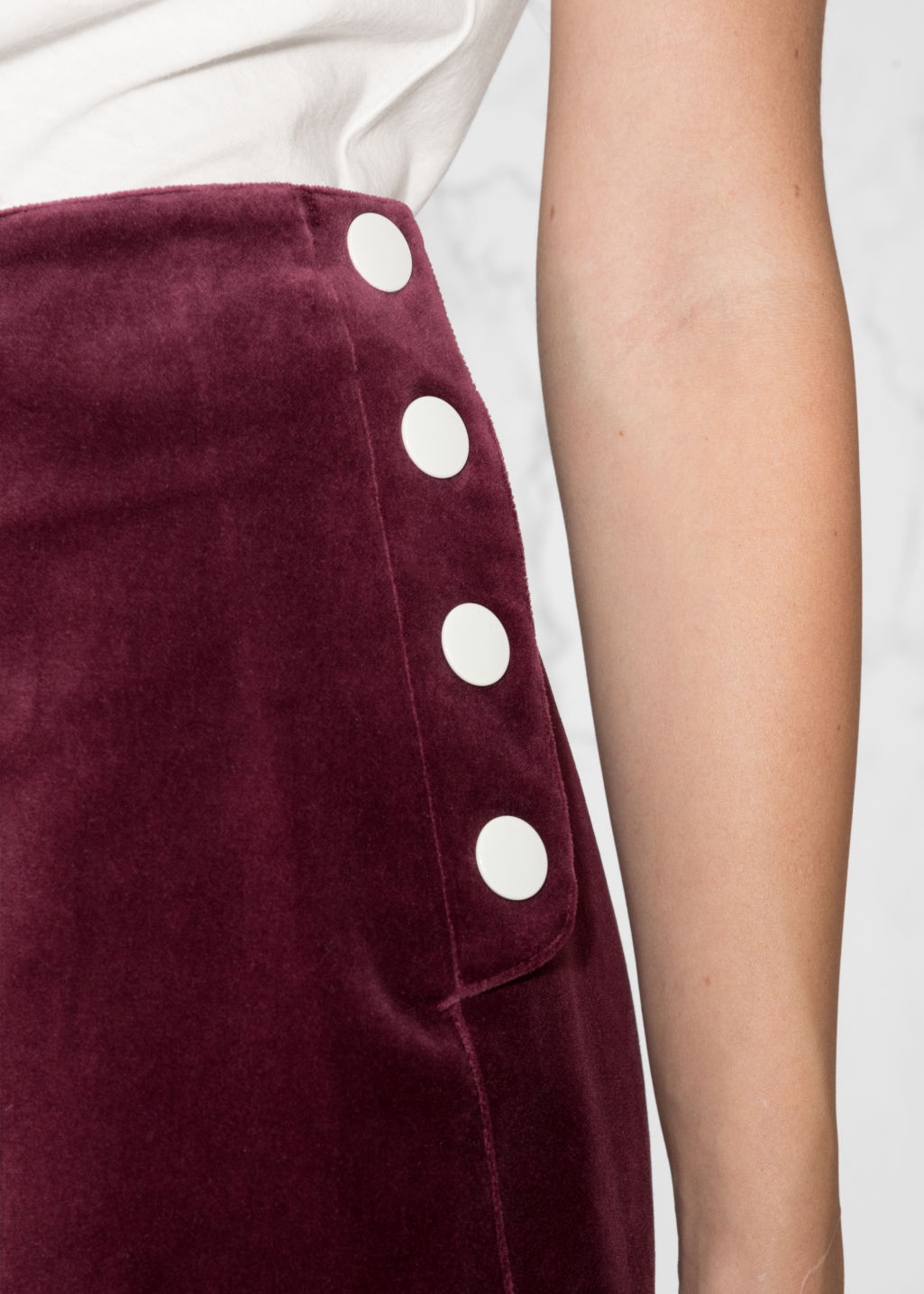 Detailed image of Stories velvet mini skirt in red
