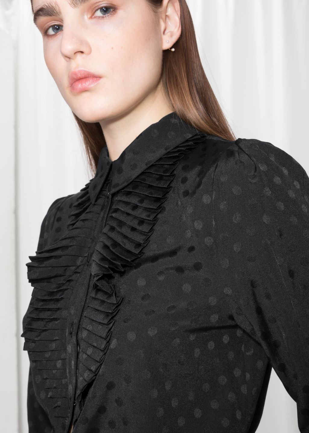 Detailed image of Stories ascot ruffle blouse in black