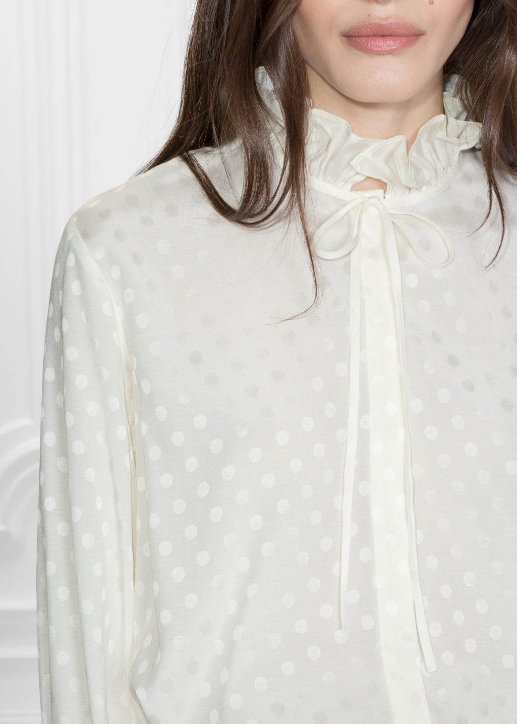 Detailed image of Stories ruffle collar blouse in white