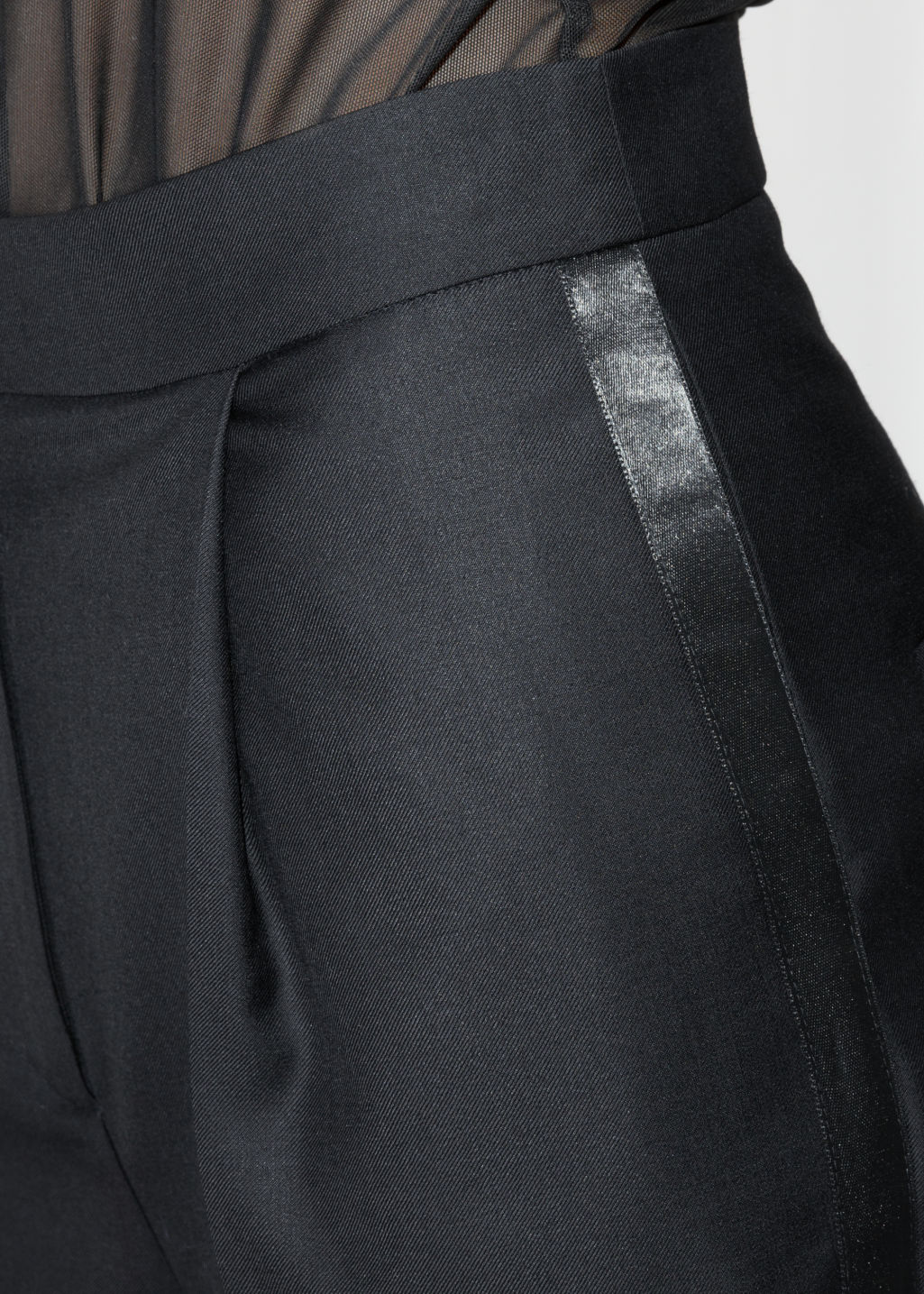 Detailed image of Stories side satin panel trousers in black