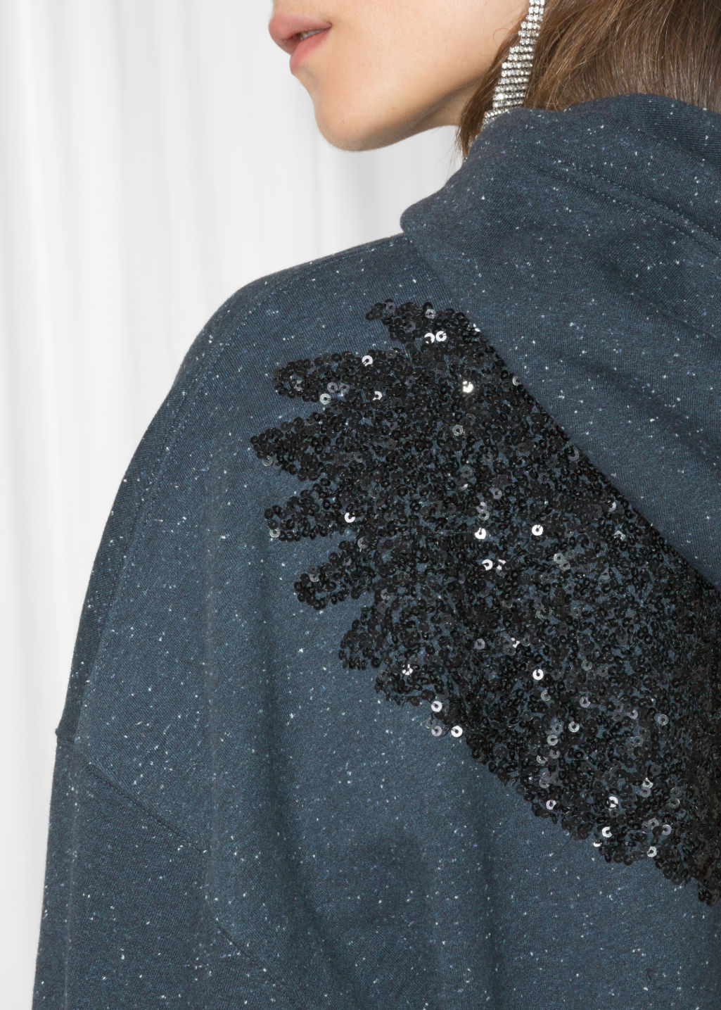 Detailed image of Stories bird sequin hoodie in blue