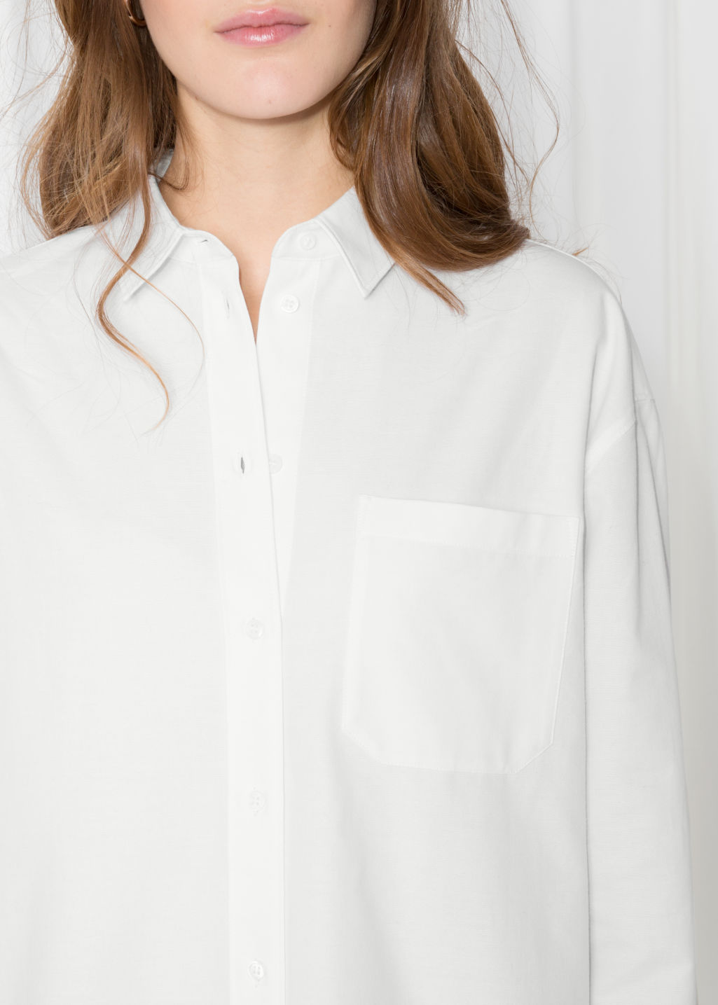 Detailed image of Stories oversized button down shirt in white