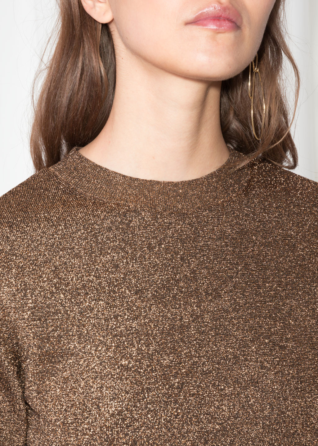 Detailed image of Stories cropped metallic longsleeve top  in gold