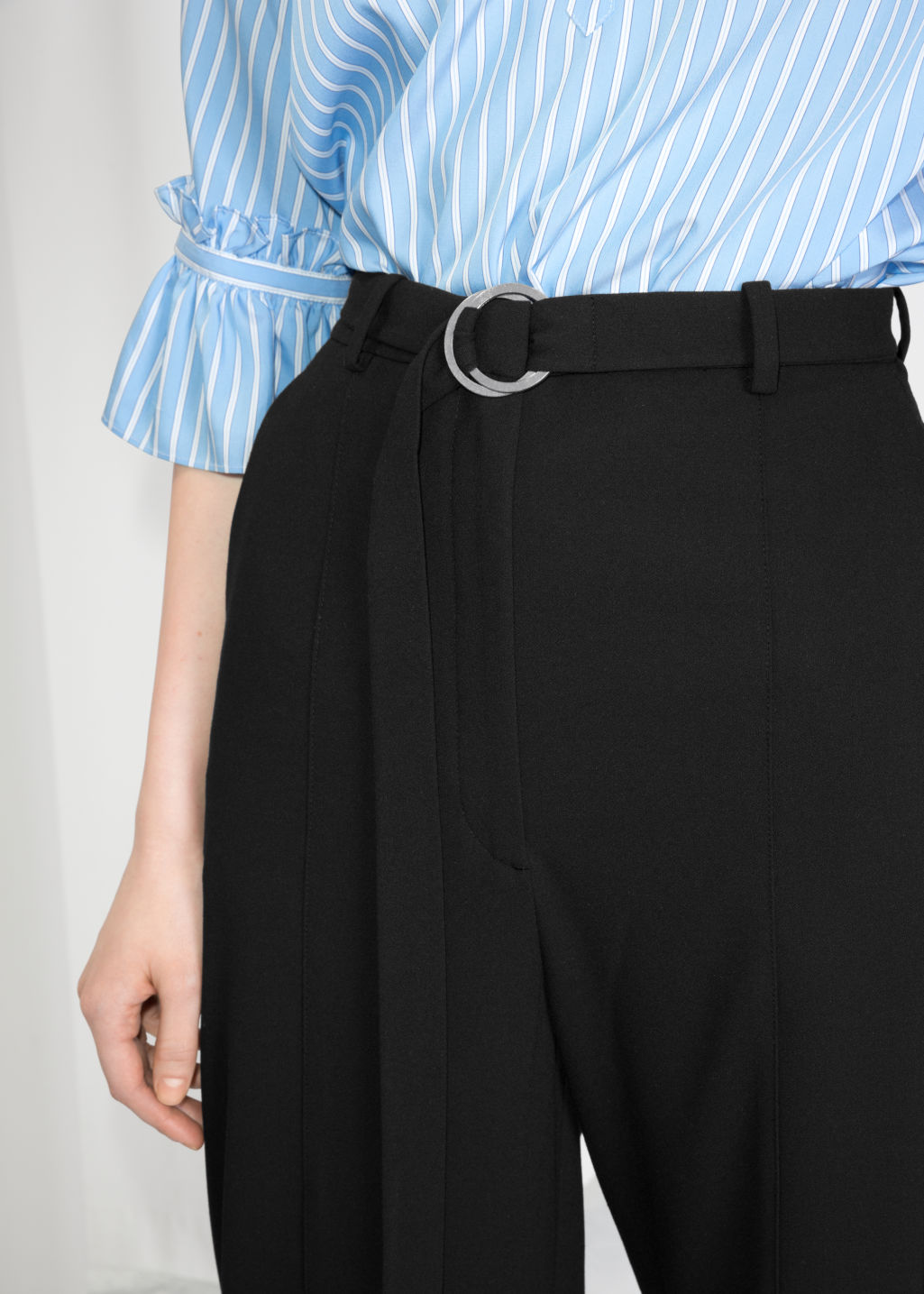 Detailed image of Stories duo o-ring belted trousers in black