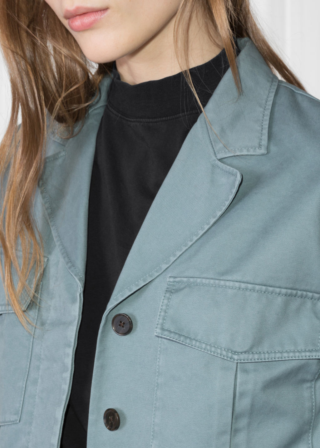 Detailed image of Stories cropped utilitarian jacket in turquoise