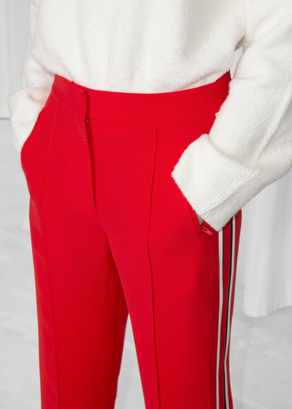 Detailed image of Stories racer stripe trousers in red