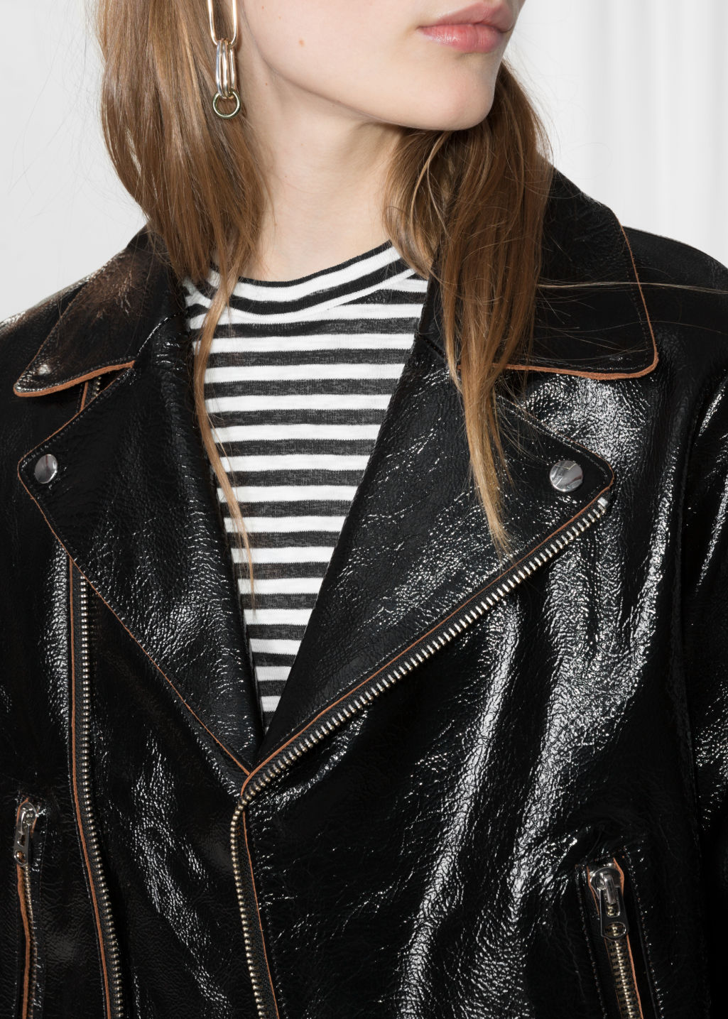 Detailed image of Stories patent leather biker jacket in black