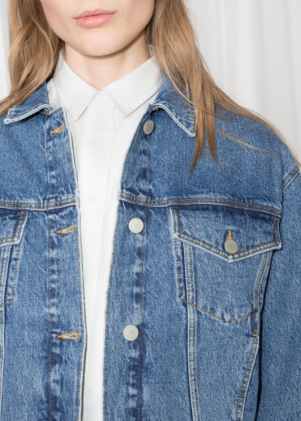 Detailed image of Stories cropped denim jacket in blue