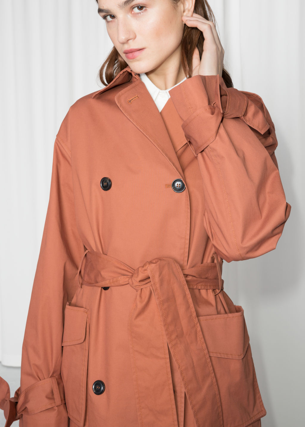Detailed image of Stories belted oversized trenchcoat in orange