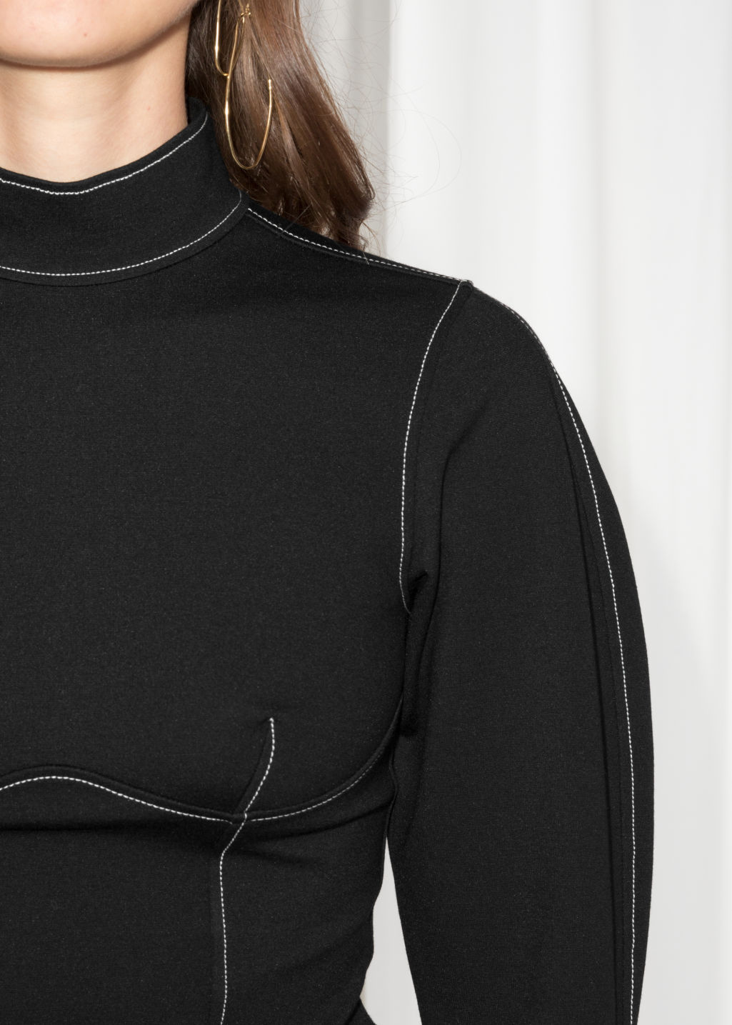 Detailed image of Stories slim sweater in black
