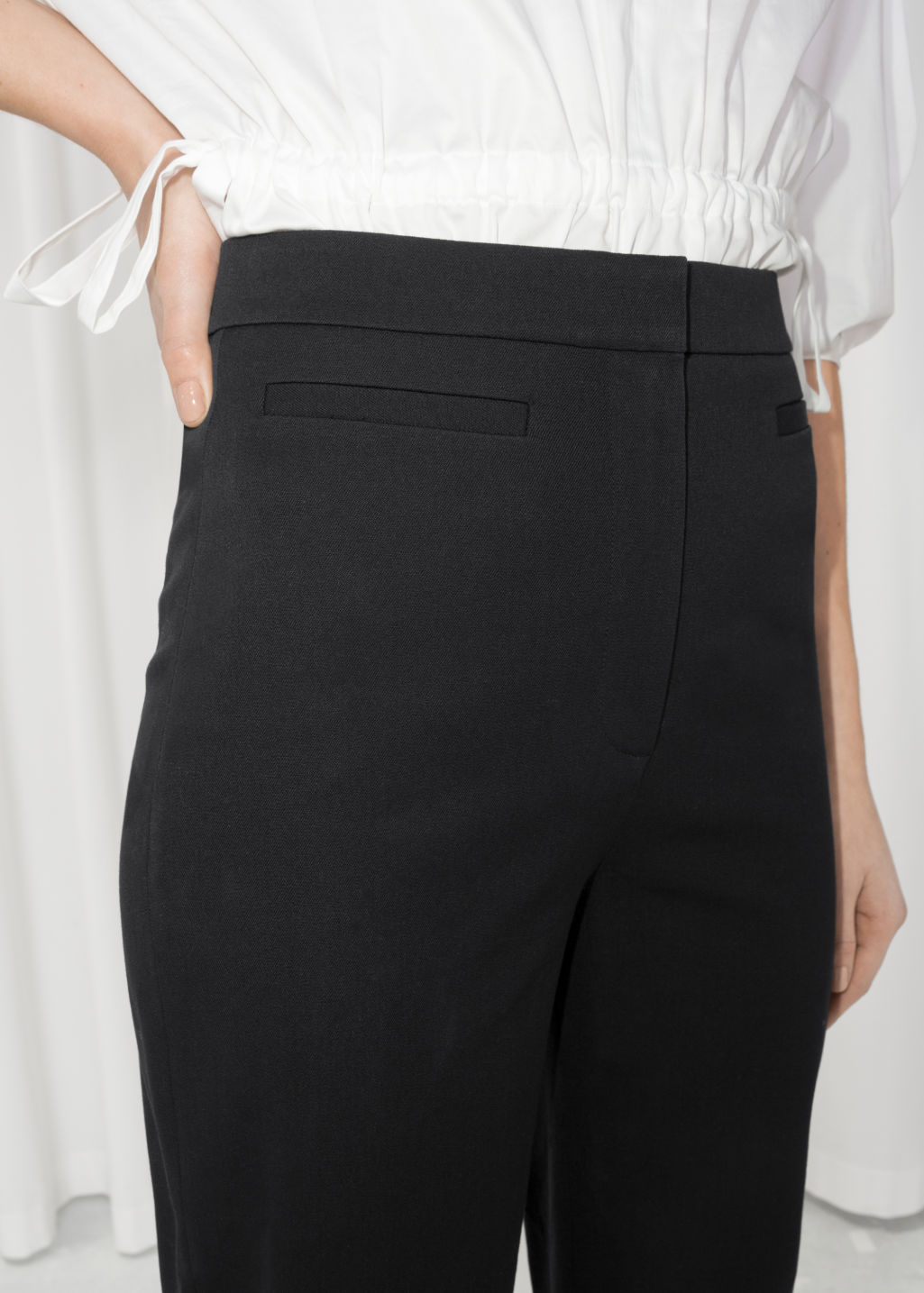 Detailed image of Stories cotton blend chinos  in black