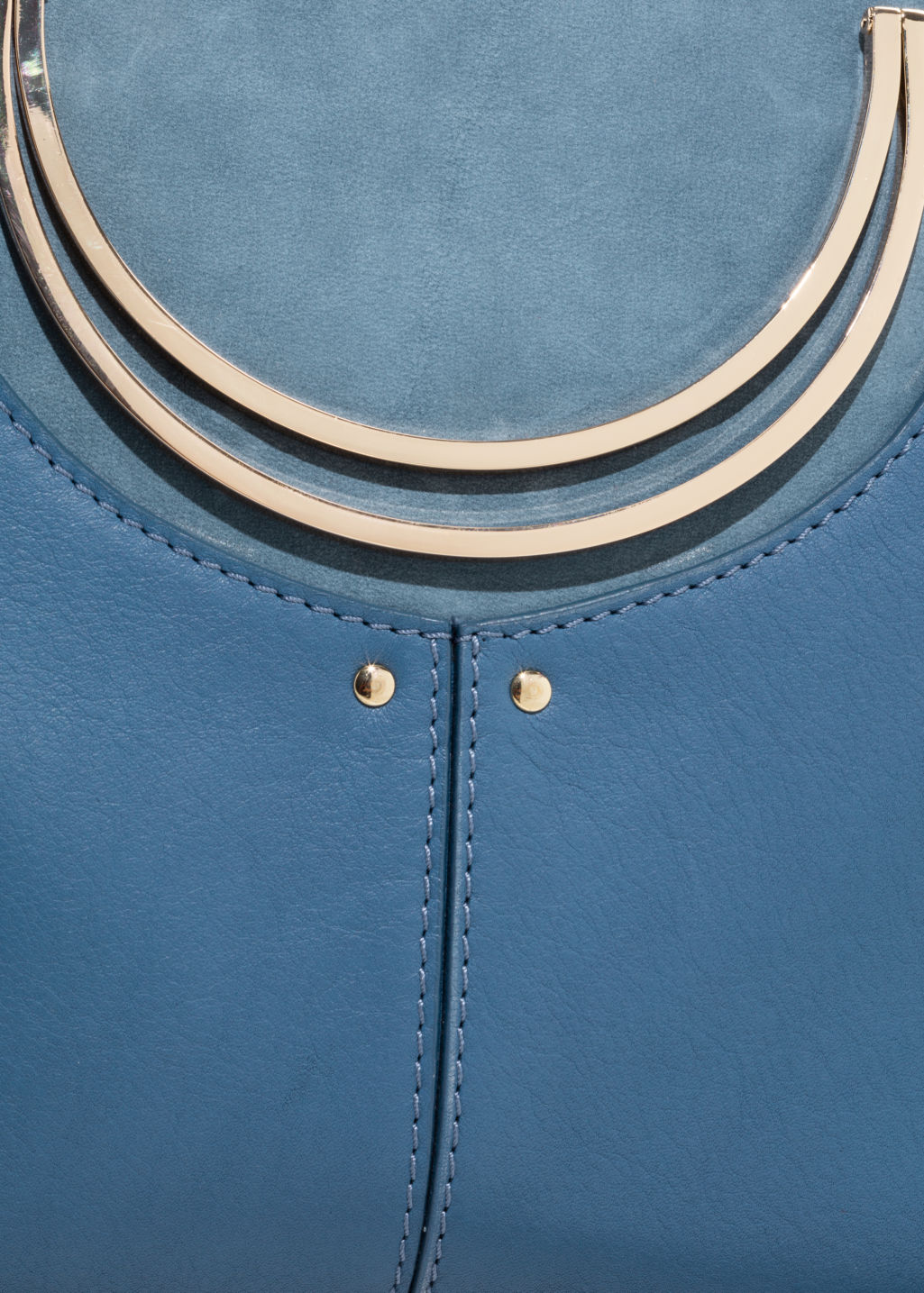 Detailed image of Stories  metal handle bag in blue