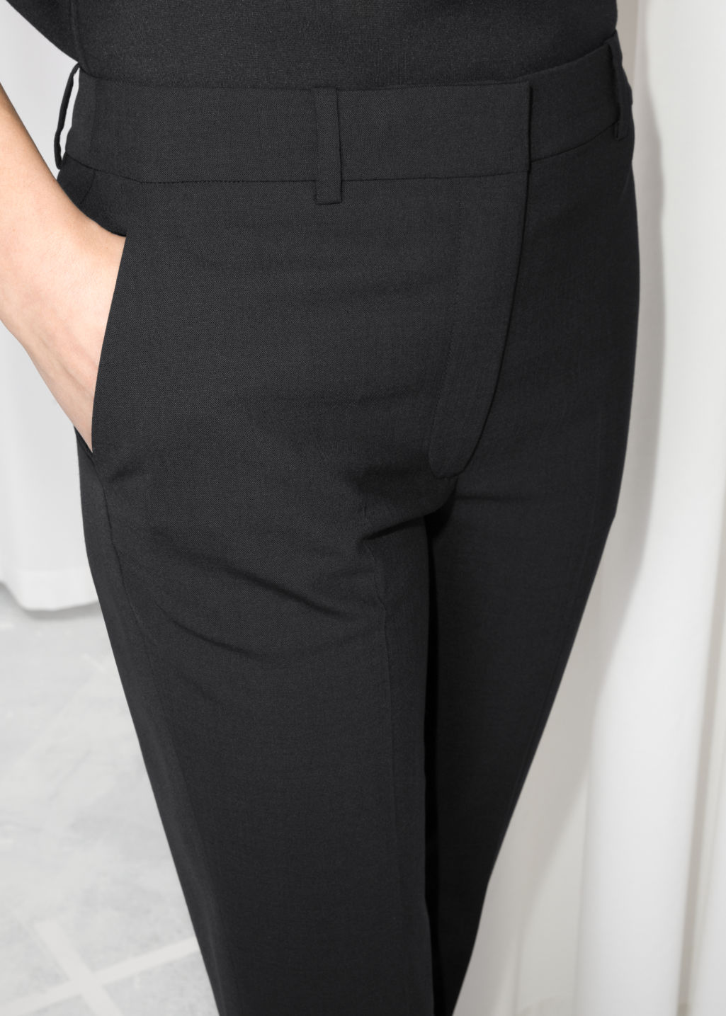 Detailed image of Stories slim fit trousers in black