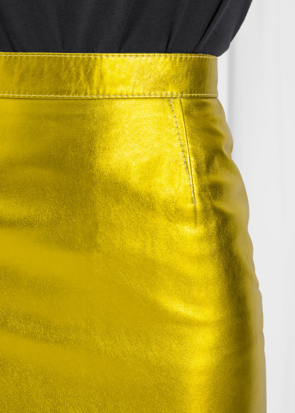 Detailed image of Stories leather skirt in yellow