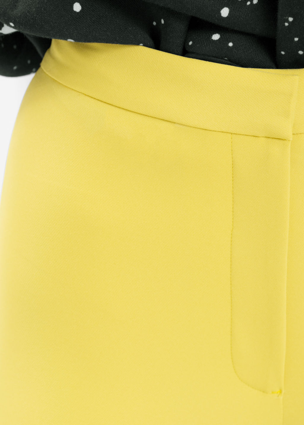 Detailed image of Stories skinny trousers in yellow