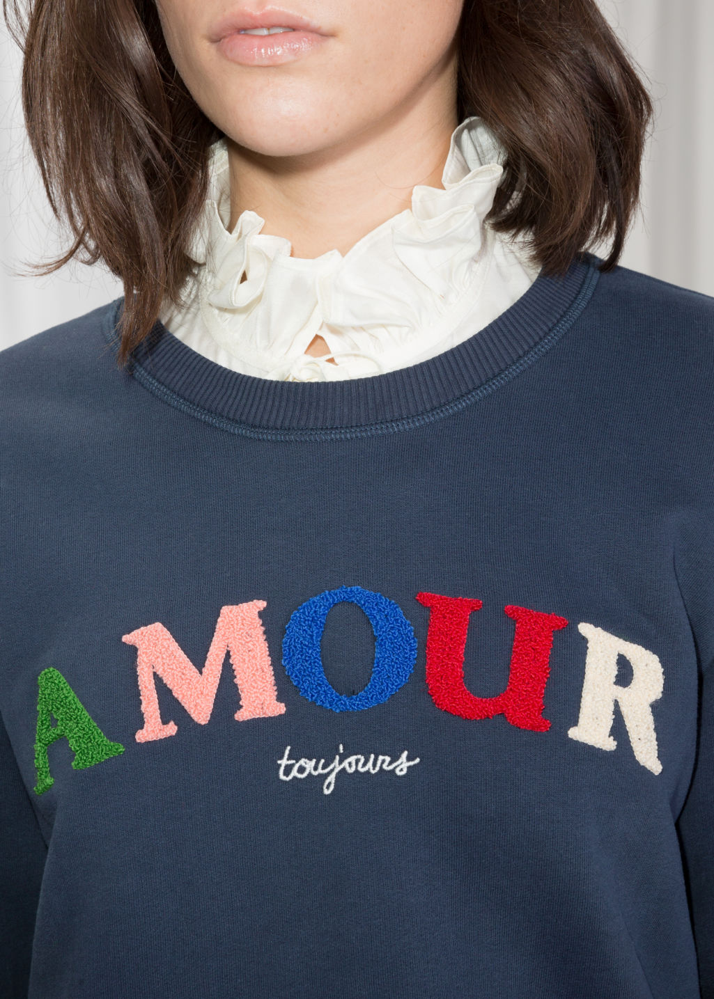 Detailed image of Stories embroidered fleece sweatshirt in blue