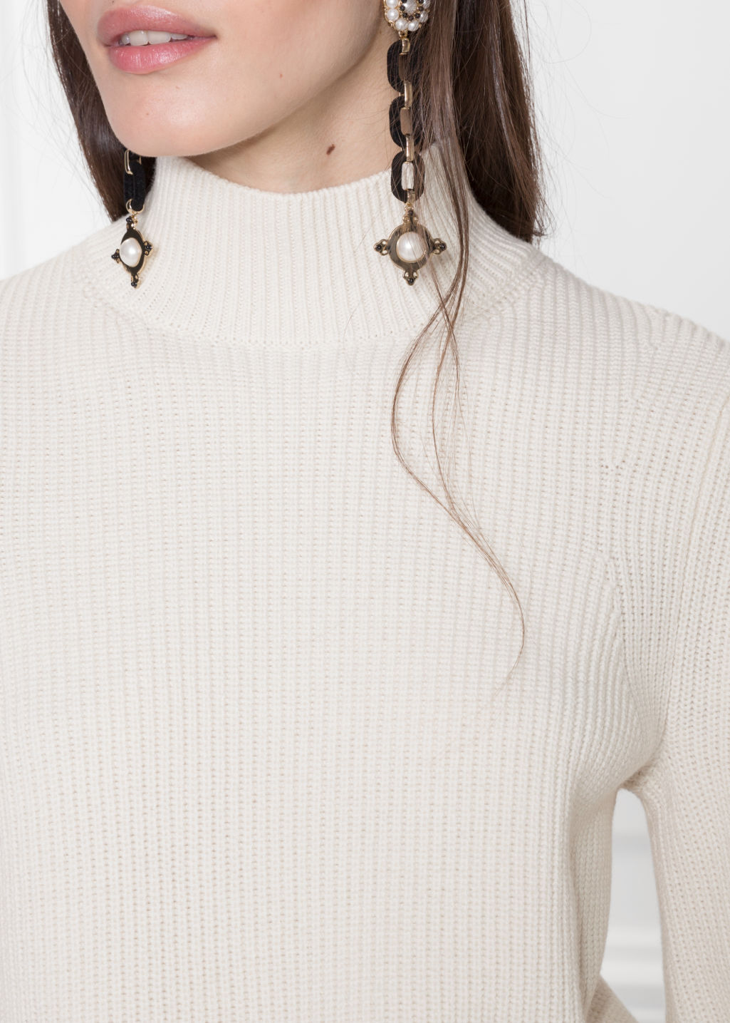 Detailed image of Stories puffy sleeve sweater in white
