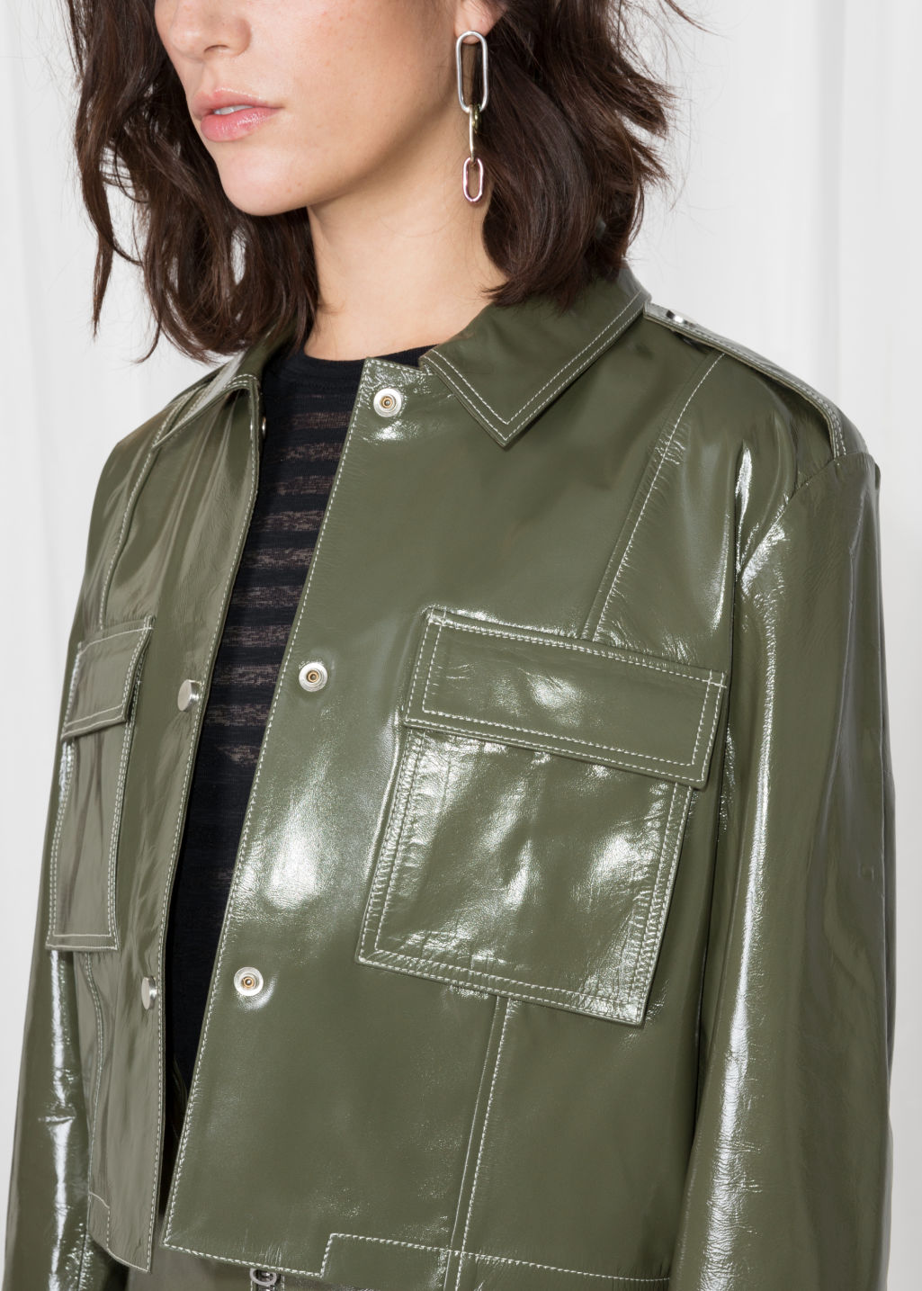 Detailed image of Stories patent leather utilitarian jacket in green