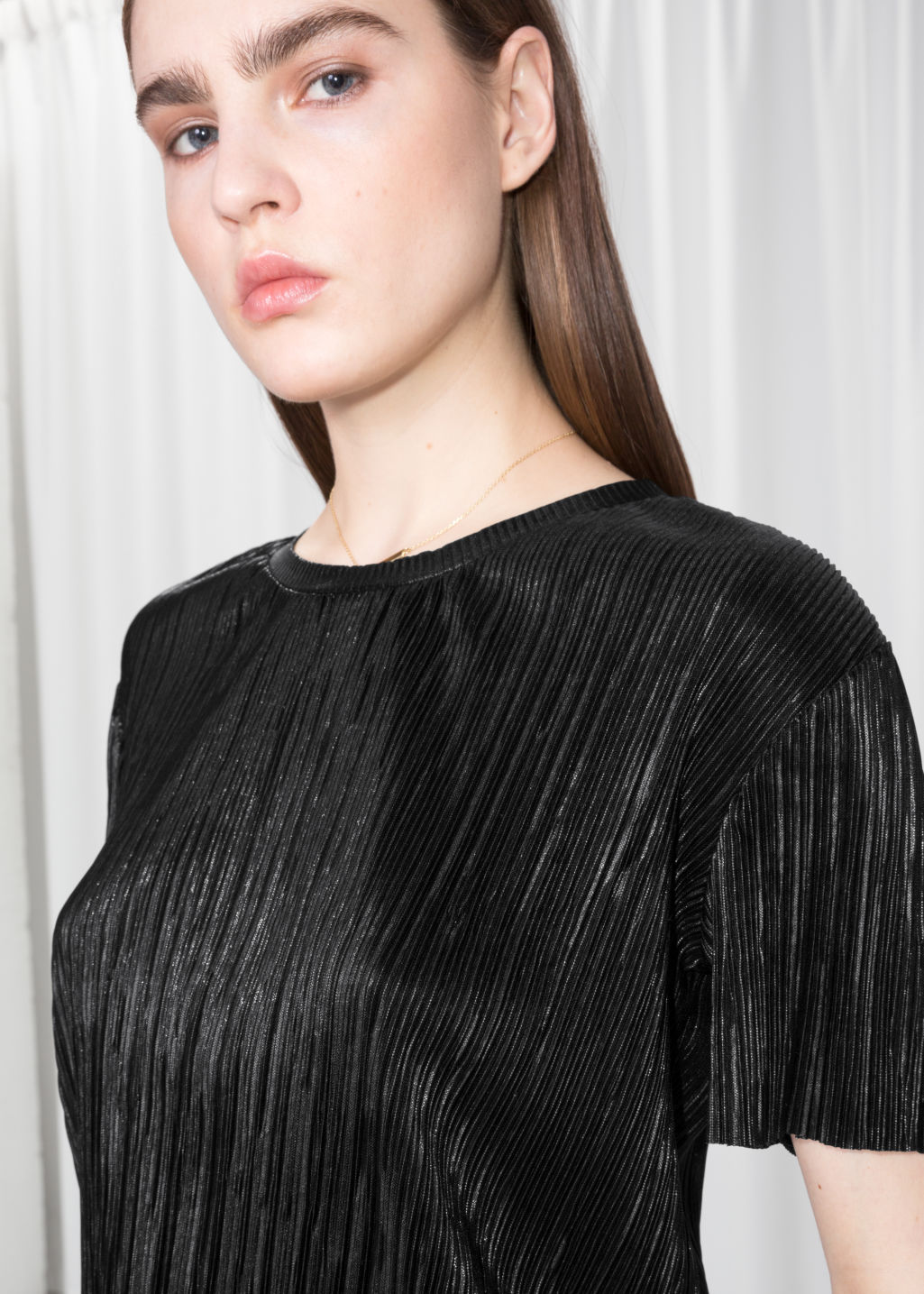 Detailed image of Stories metallic top in black