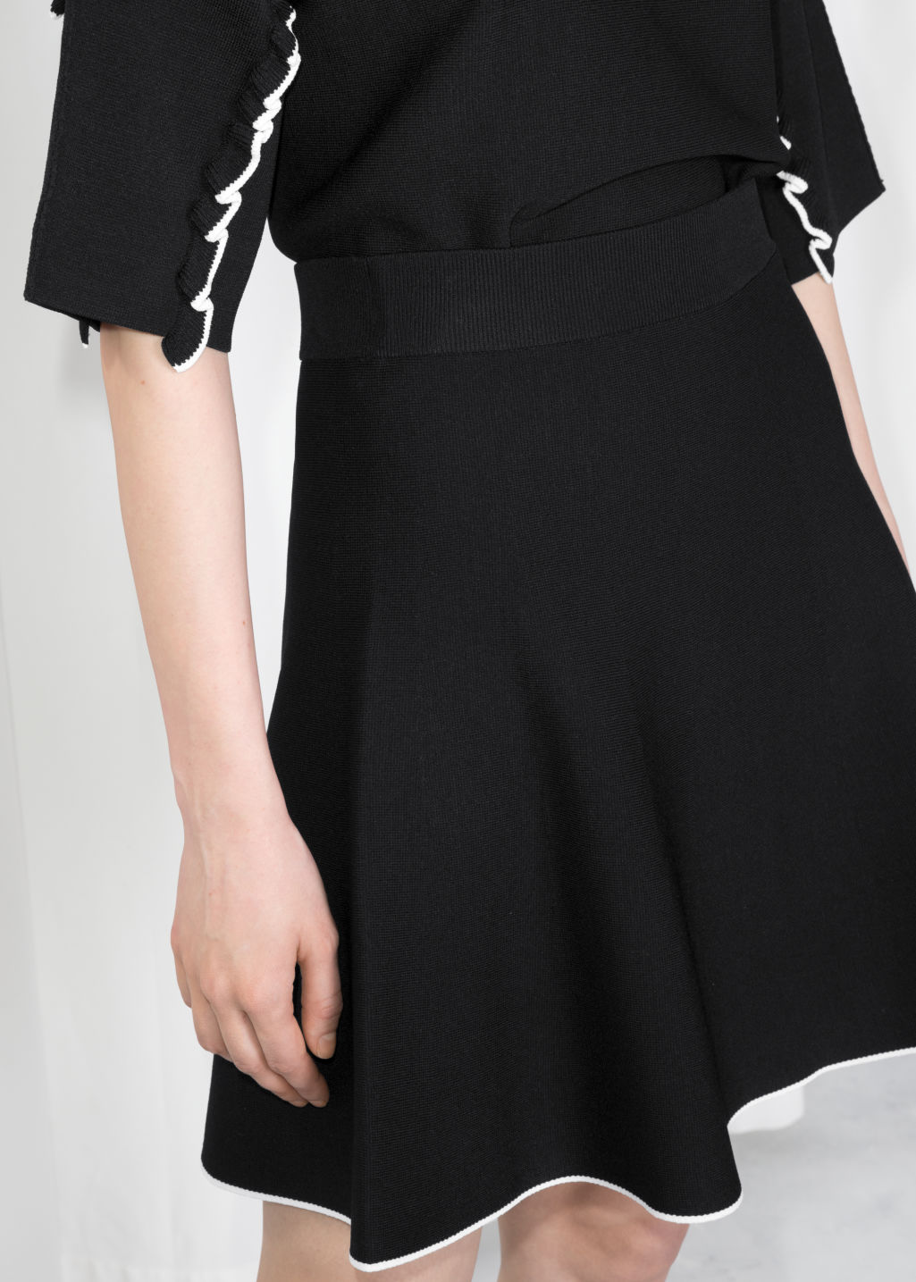 Detailed image of Stories a-line knit skirt in black