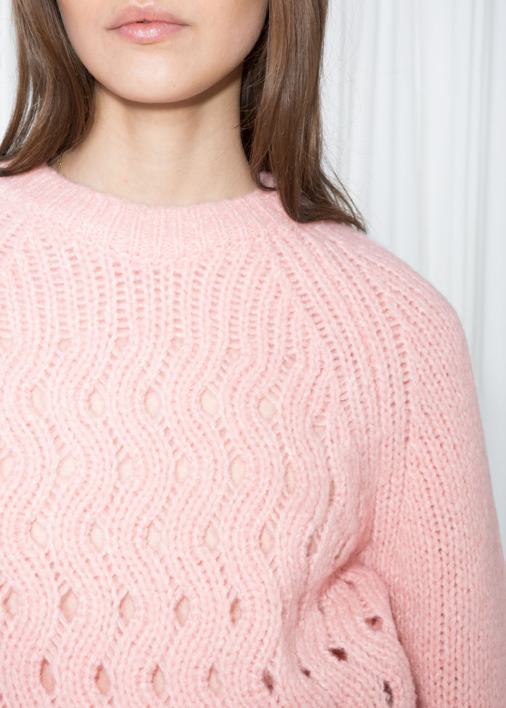 Detailed image of Stories zig zag eyelet sweater in pink