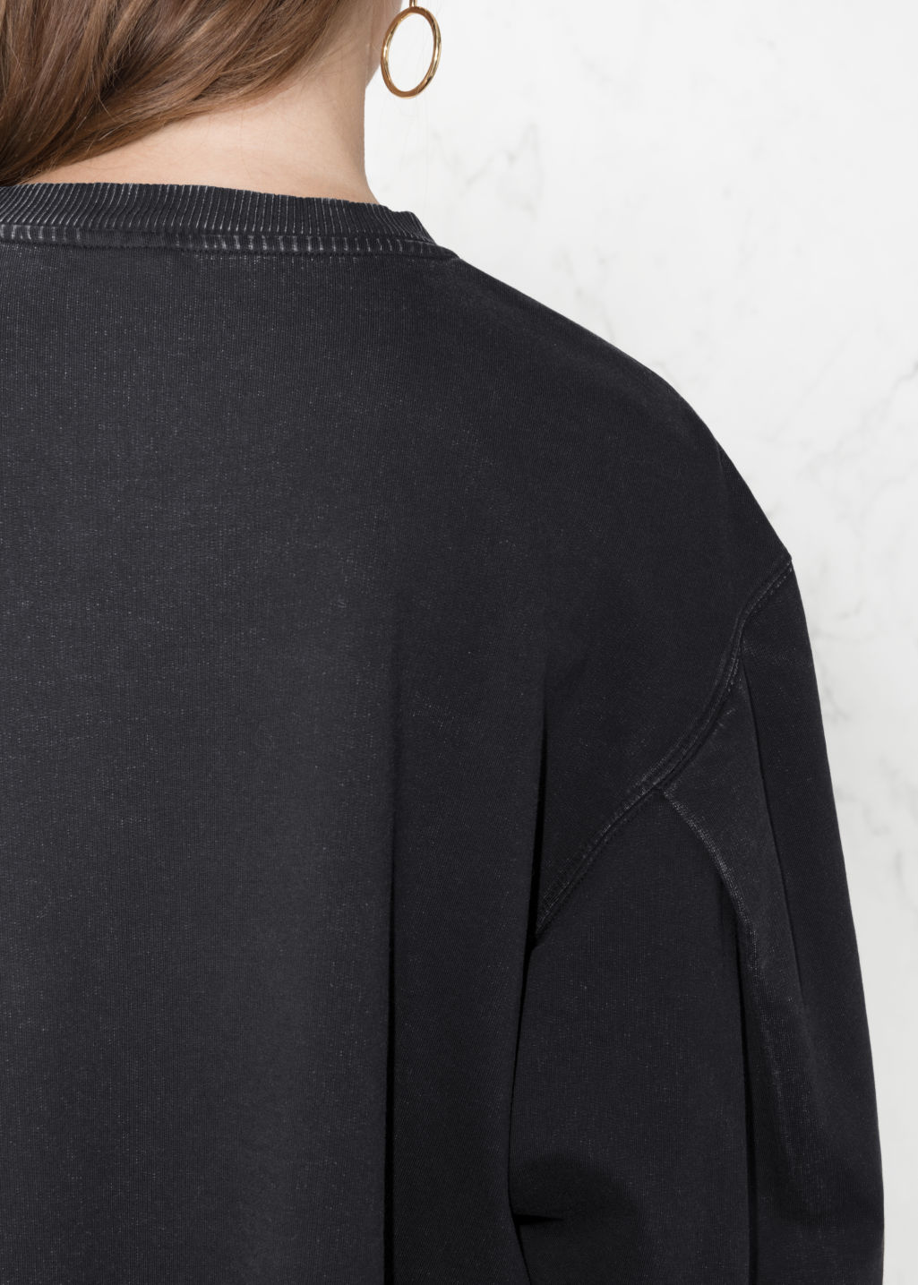 Detailed image of Stories cropped pullover in black